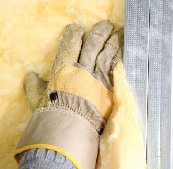 installing fiberglass insulation